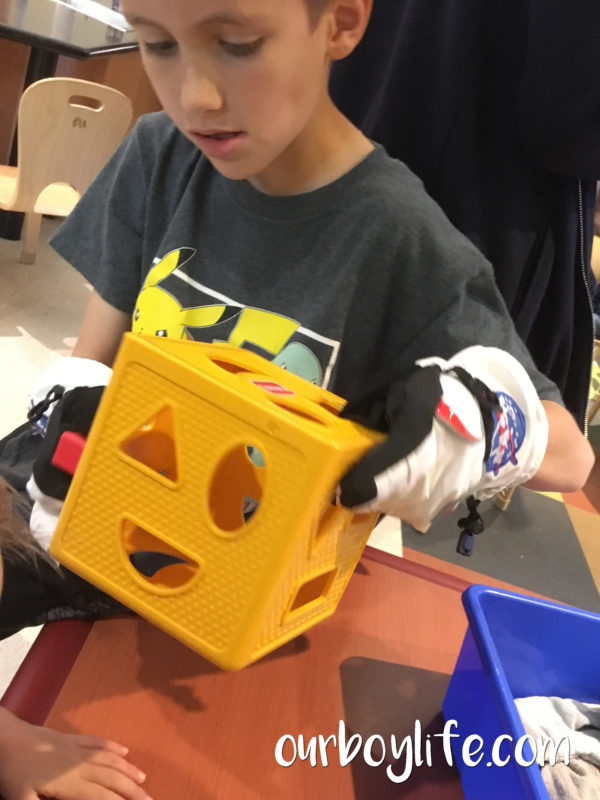 Our Boy Life - Shape sorting with gloves