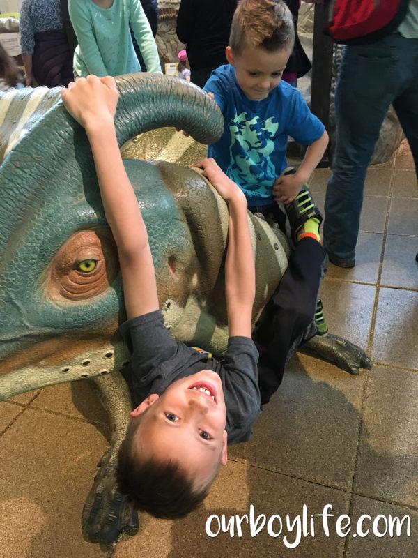 Our Boy Life - Climbing on a dinosaur